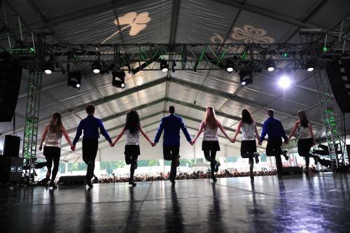A troupe of Irish Dancers on stage performing at the Dublin Irish Festival.