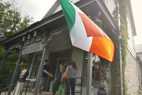 Irish flag and front porch of Ha'penny Bridge Imports of Ireland in Hisotric Dublin, Ohio.
