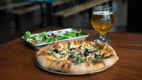 Personal size pizza salad and beer from Pinthouse Pizza