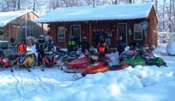 Snowmobilers at Cabin