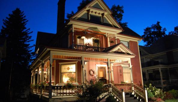 The nighttime lights highlight the gorgeous architecture at Bella Rose B&B
