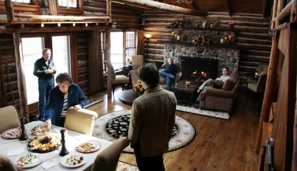 Dining and living area at Chalet B&B, complete with a fireplace