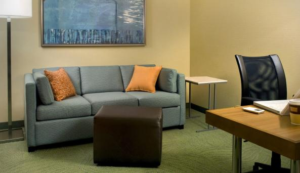Our large guest rooms offer a separate living area with kitchenette