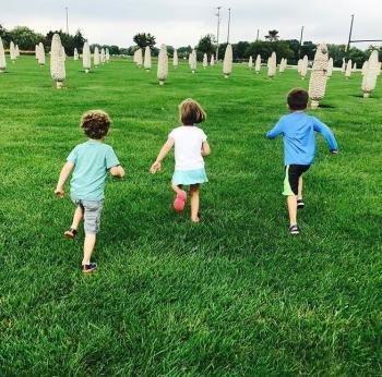 Kids running through the field of corn