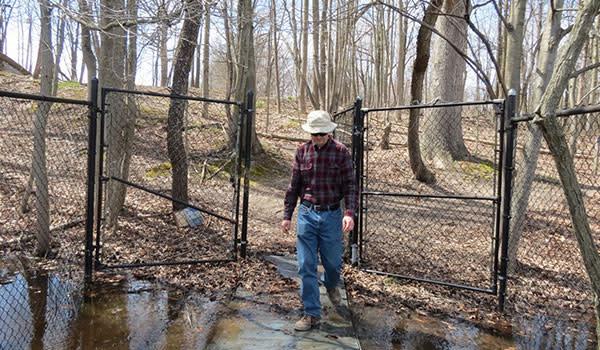 Guy Walking Out of Michael Nichols Pinhook Bog gate