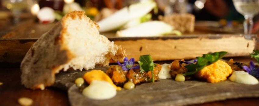 Bread on board with other food at FLX Table in Geneava