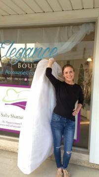 Helton gown shopping at Elegance Boutique
