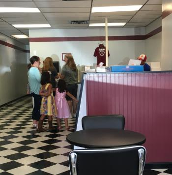 Folks are lining up to get a donut from Red's.