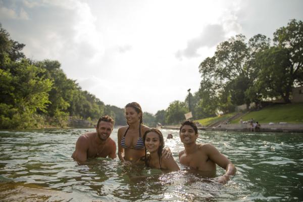 Four people swimming in Barton Springs Pool