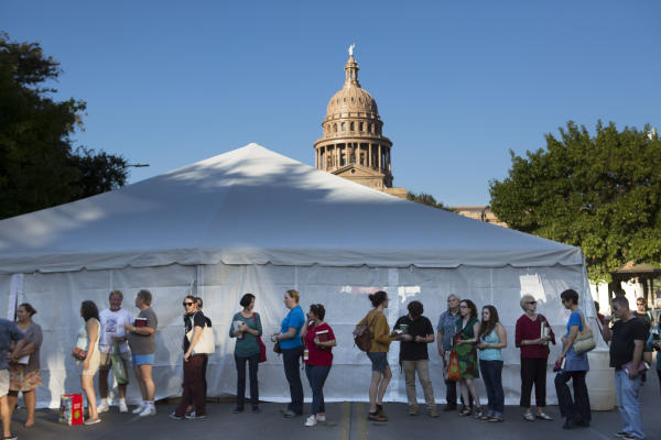 People wait in line at the Texas Book Festival in front of the capitol building