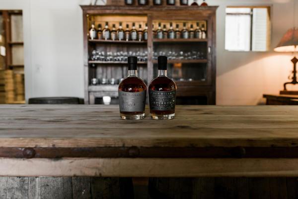 Ben Milam Bourbon and Rye bottles on a bar