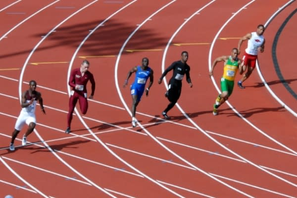NCAA Track Meet by Archie Campbell