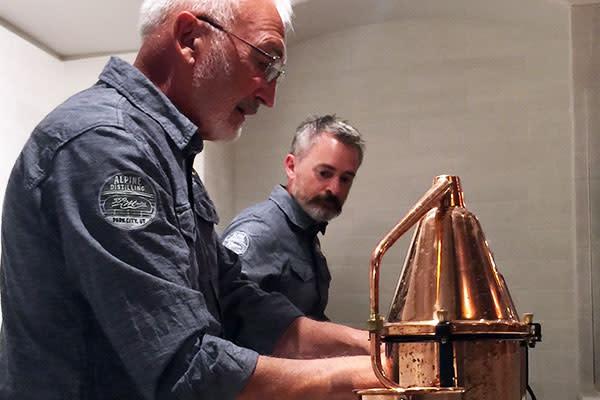 Distillers setting up stills of gin