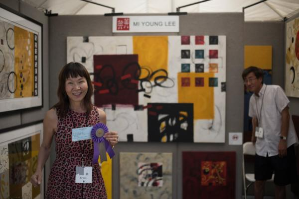 Artist MiYoung Lee and her booth from Art City Austin 2015