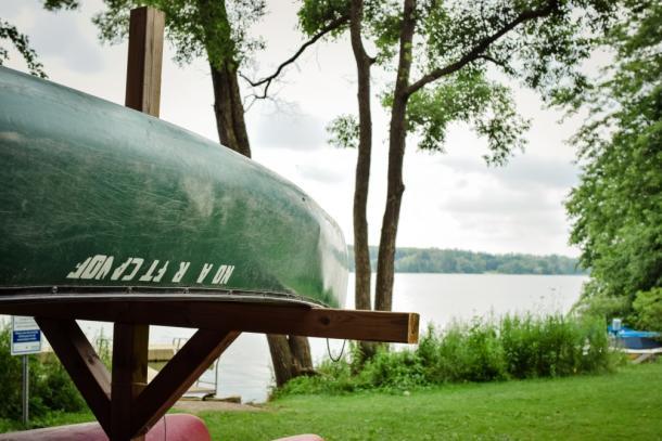 Canoe upside down along the shore