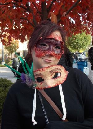 This young woman stunned other walkers at the annual Zombie Walk with her horrifying - and very creative - skin mask.
