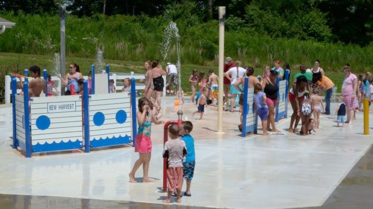 Families playing at New Harvest Splash Pad