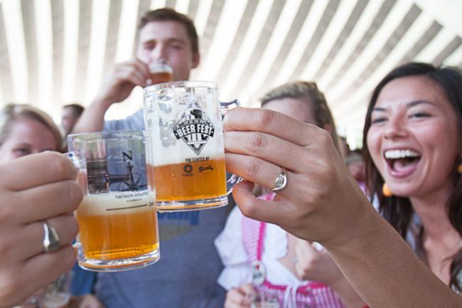 People enjoying Top of the Hops Beer Festival