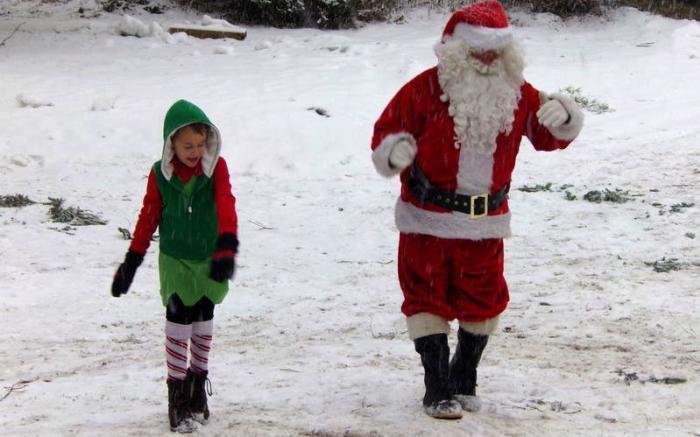 Jeffrey the elf and Santa moon walking.