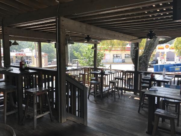 A local, coastal grill restaurant's patio.