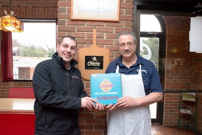 Zach Brown (l), VFTCB Online Marketing/Research Manager, presents last year's winner, Pete Chiaro, with his marketing kit, one of 64 that went to the participating pizzarias countywide.. Online voting for the 2017 Montco's Best Pizza Tournament at valleyforge.org ends April 2.