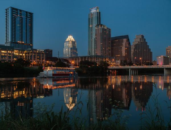 Lady Bird Lake and downtown skyline at night