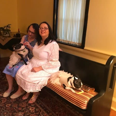 Same sex couple and french bulldogs during wedding at Joy Burke's home