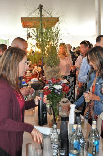 People sampling wine