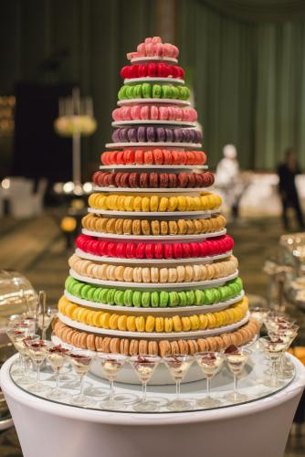 Wedding cake made from tiers multi-colored macarons.