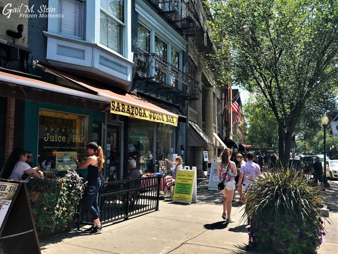 Yellow awning of Saratoga Juice along Broadway