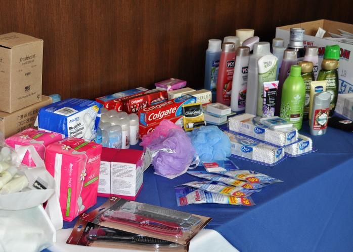 Table filled with toiletries as donations to Wellspring