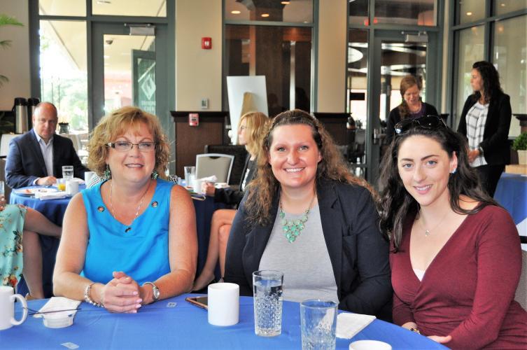 3 women finishing breakfast at table