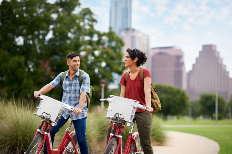 pair biking on the Butler Hike and Bike Trail in downtown austin texas