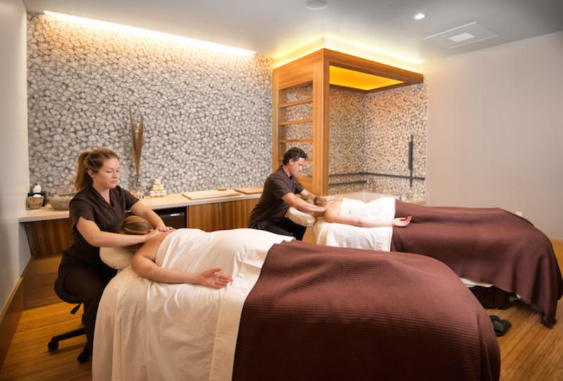 Two people getting massage in the spa at Cedarbrook