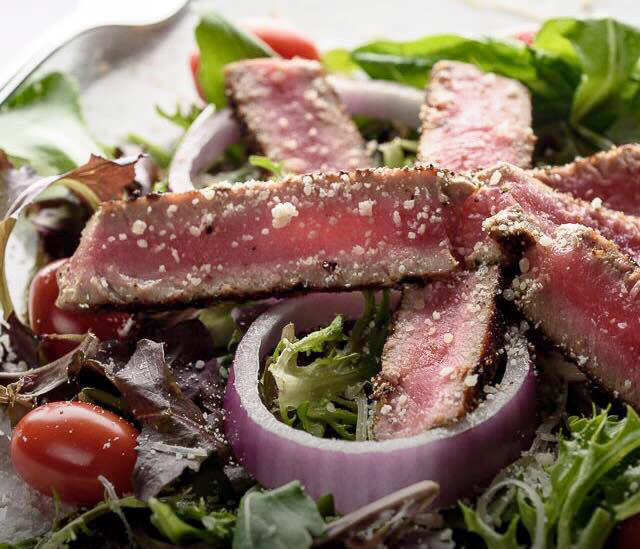 Try Luna Bar & Grill's Yellow Fin Tuna salad with house made dressing.