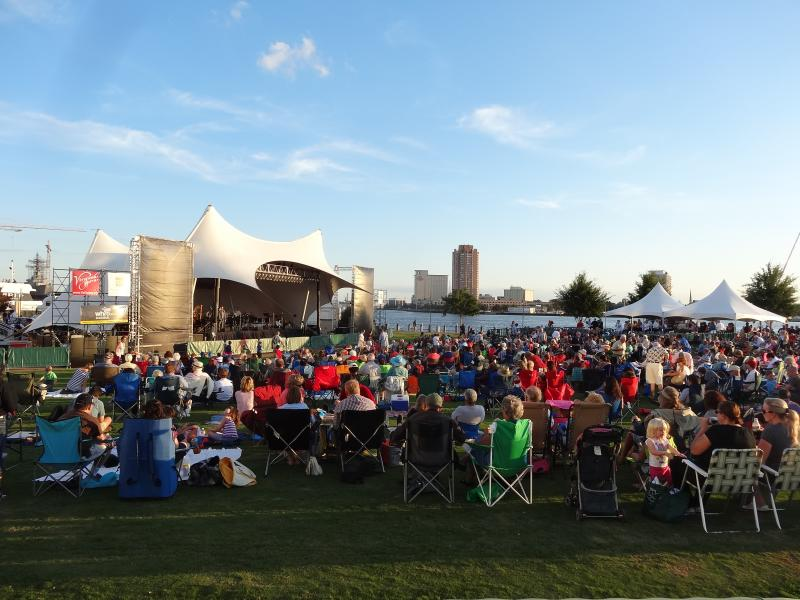 Attendees enjoying a performance at Symphony in the Park in Norfolk