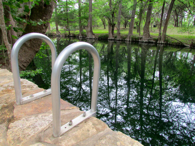 ladder to swimming hole at Blue Hole outside of Austin Texas