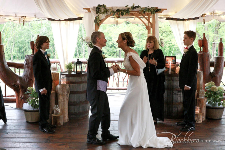 Couple smiling and holding hands during wedding ceremony at Saratoga Winery