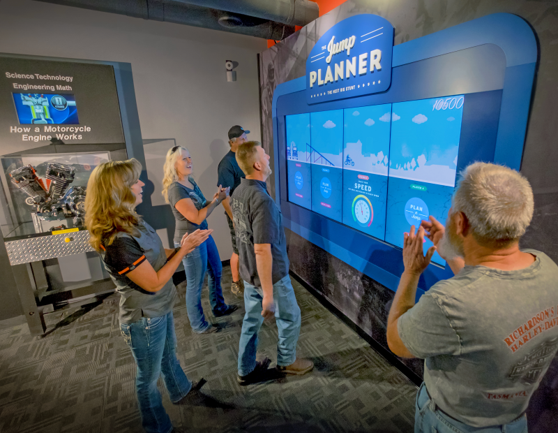 Visitors react with excitement to the Plan Your Jump interactive display at the Evel Knievel Museum in Topeka, Kansas