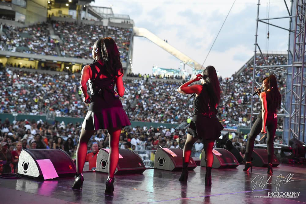 Three performers seen from the back on a stage at Paul Brown Stadium at Cincinnati Music Festival