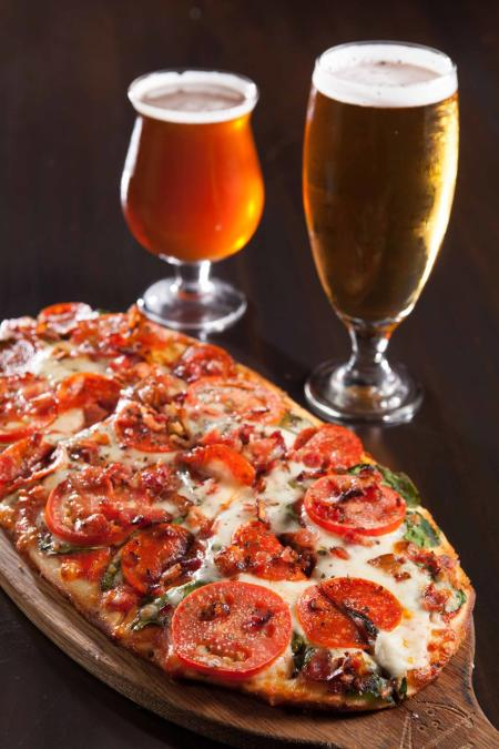 Unwind and pair your personal pizza with a glass of wine! (Photo courtesy of Pizza Lounge)