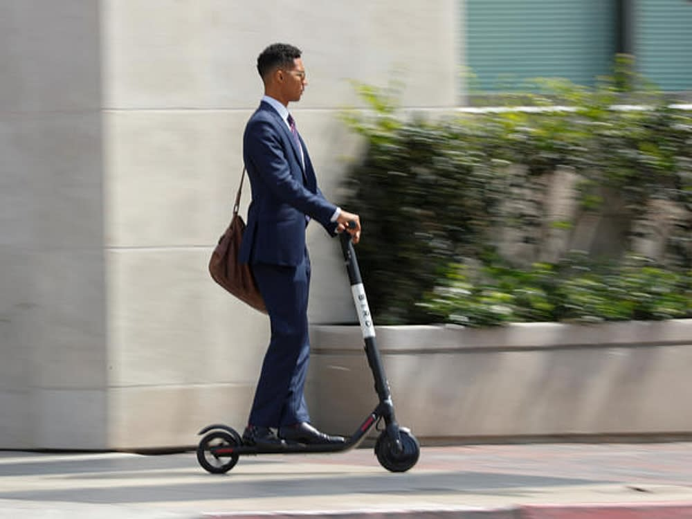Scootin' Past The Morning Rush to Work