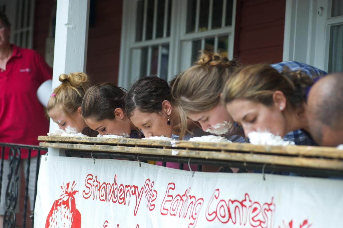 Competitors race to finish their sweet strawberry pies at the annual Strawberry Festival at Peddler's Village, a 42-acre shopping village that hosts special events throughout the year.