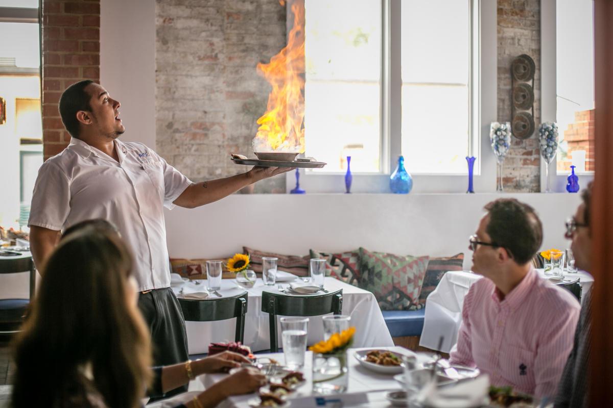 Waiter serving at Ayse Meze