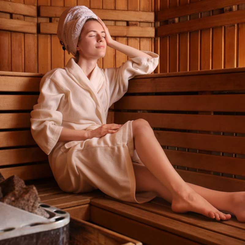 Woman enjoying the sauna during her spa day