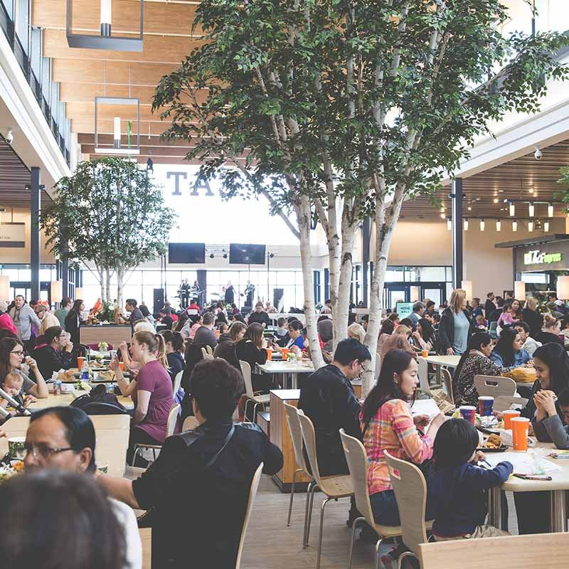 People eating at the food court at the Outlet Collection Winnipeg