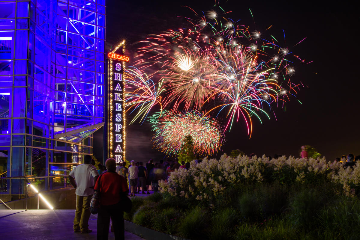 View of fireworks and Shakespeare Theatre at the Pier at night