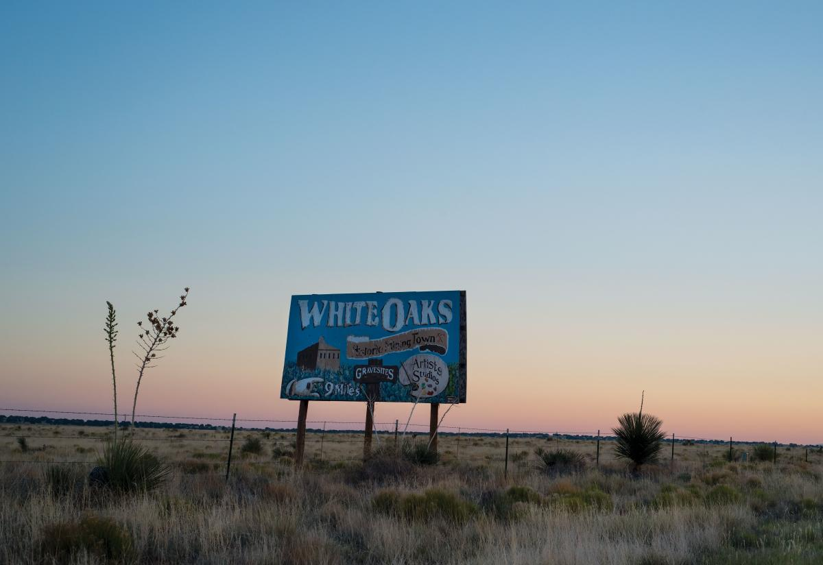 A road sign directs visitors to historic White Oaks, just north of Carizozo.