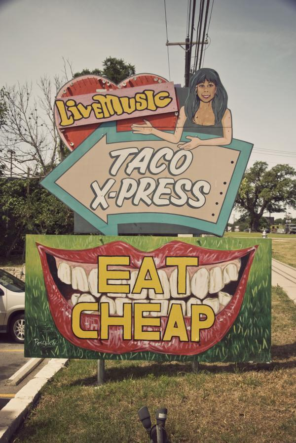 Sign at Marias with text saying live music taco xpress eat cheap
