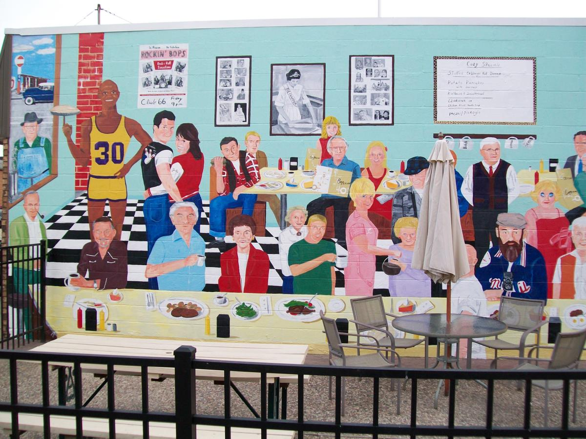Downtown Stevens Point Mural at Cozy Kitchen, painted by local artist Greg Luedtke.